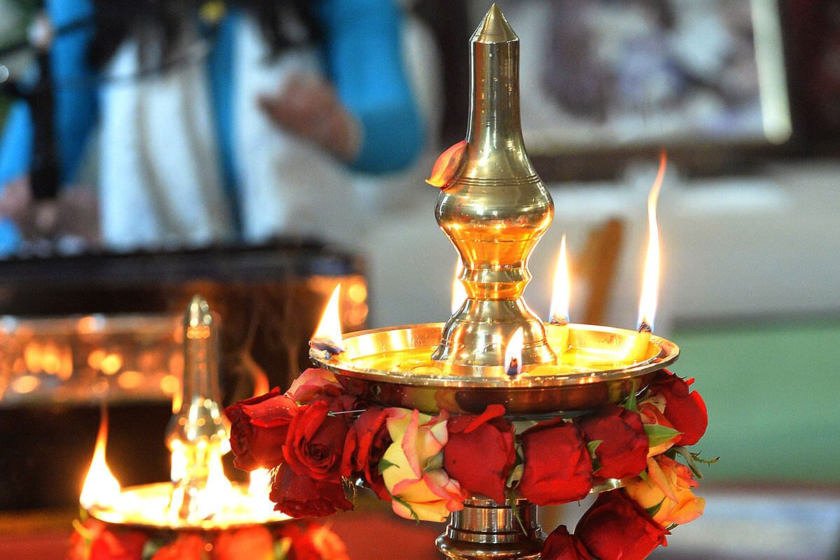 Puja oil lamps and flowers